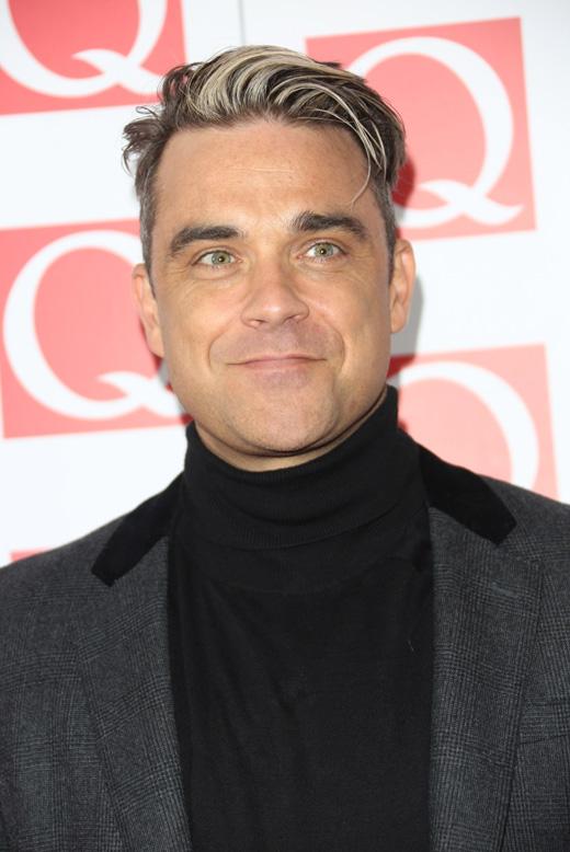 Робби Уильямс (Robbie Williams) / © Featureflash / Shutterstock.com